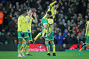 Norwich City midfielder Nelson Oliveira is held aloft after scoring his 3rd goal by Norwich City defender Russell Martin during  the EFL Sky Bet Championship match between Norwich City and Derby County at Carrow Road, Norwich, England on 2 January 2017. Photo by Nigel Cole.