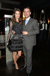 SARAH ANN MACKLIN and FREDDIE WATERS at the OMEGA VIP dinner hosted by Cindy Crawford and OMEGA President Mr. Stephen Urquhart held at aqua shard', Level 31, The Shard, 31 St Thomas Street, London, SE1 9RY on 10th December 2014.