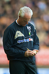 WOLVERHAMPTON, ENGLAND - Saturday, October 24, 2009: Wolverhampton Wanderers' manager Mick McCarthy makes notes during the Premiership match against Aston Villa at Molineux. (Photo by David Rawcliffe/Propaganda)