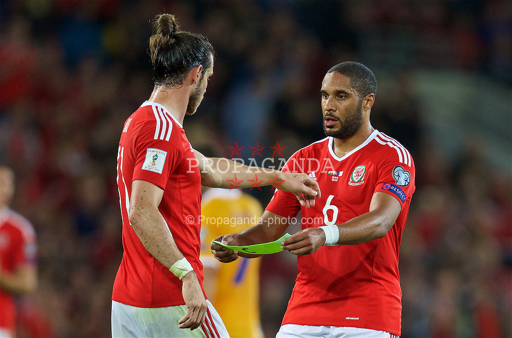 CARDIFF, WALES - Monday, September 5, 2016: Wales' captain Ashley Williams hands over the armband to Gareth Bale during the 2018 FIFA World Cup Qualifying Group D match against Moldova at the Cardiff City Stadium. (Pic by David Rawcliffe/Propaganda)