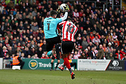 Exeter City goalkeeper Christy Pym (1) takes the ball from the head of Lincoln City forward Matt Green (10)  during the EFL Sky Bet League 2 match between Lincoln City and Exeter City at Sincil Bank, Lincoln, United Kingdom on 30 March 2018. Picture by Mick Atkins.