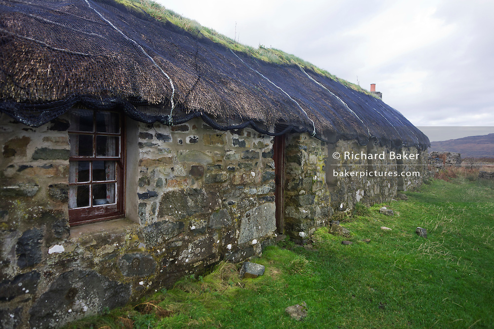 Remains of old home called Sheila's Cottage, last inhabited by the local milk maid of the same name in the 1930s  on Ulva, Isle of Mull, Scotland. Ulva is home to Sheila's Cottage, a restored thatched croft house once the home of Sheila MacFadyen. Here you can learn about the famous visitors to Ulva, Boswell and Dr Johnson, Lachlan Macquarie and Sir Walter Scott. Beatrix Potter was a regular visitor to the island and found inspiration for many of her books here. The grandparents of the famous explorer and missionary David Livingstone once lived on Ulva and the walk up to Livingstone's croft is a must.