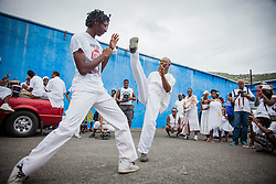 Benjamin Berry, left, with father Donovan perform Capoeira, an Afro-Brazilian martial arts form.  10th Annual Dollar Fo' Dollar Culture & History Tour commemorating the anniversary of the successful protest  demanding better pay by Queen Coziah and the 19th century coal laborers in the streets of downtown Charlotte Amalie.  12 September 2015.  St. Thomas, VI.  © Aisha-Zakiya Boyd10th Annual Dollar Fo' Dollar Culture & History Tour commemorating the anniversary of the successful protest  demanding better pay by Queen Coziah and the 19th century coal laborers in the streets of downtown Charlotte Amalie.  12 September 2015.  St. Thomas, VI.  © Aisha-Zakiya Boyd