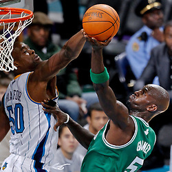 December 28, 2011; New Orleans, LA, USA; Boston Celtics power forward Kevin Garnett (5) has his shot blocked by New Orleans Hornets center Emeka Okafor (50) during the fourth quarter of a game at the New Orleans Arena. The Hornets defeated the Celtics 97-78.  Mandatory Credit: Derick E. Hingle-US PRESSWIRE