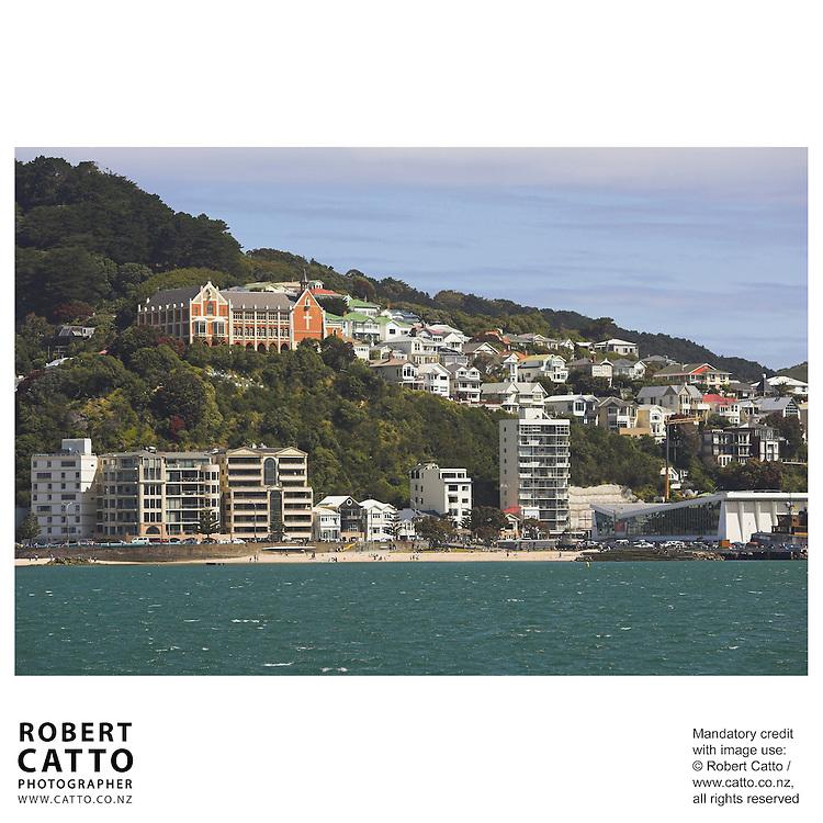 Oriental Bay beach with St Gerard's Monastery seen from Lambton Harbour, Wellington, New Zealand.<br />