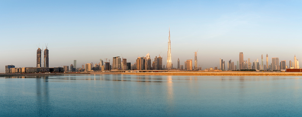 Skyline of towers beside the Creek at dawn in Business Bay  in Dubai United Arab Emirates