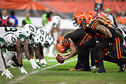 The Cleveland Browns offensive line makes a move at the snap of the ball opposite the New York Jets defensive line at the line of scrimmage during the 2018 NFL regular season week 3 football game against the New York Jets on Thursday, Sept. 20, 2018 in Cleveland. The Browns won the game 21-17. (©Paul Anthony Spinelli)