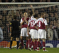 Fotball<br /> Champions League 2004/05<br /> Arsenal v Panathinaikos<br /> 2. november 2004<br /> Foto: Digitalsport<br /> NORWAY ONLY<br /> Arsenal's Pascal Cygan looks unhappy as the referee gives a penalty to Panathinaikos. The French defender also scored an own goal