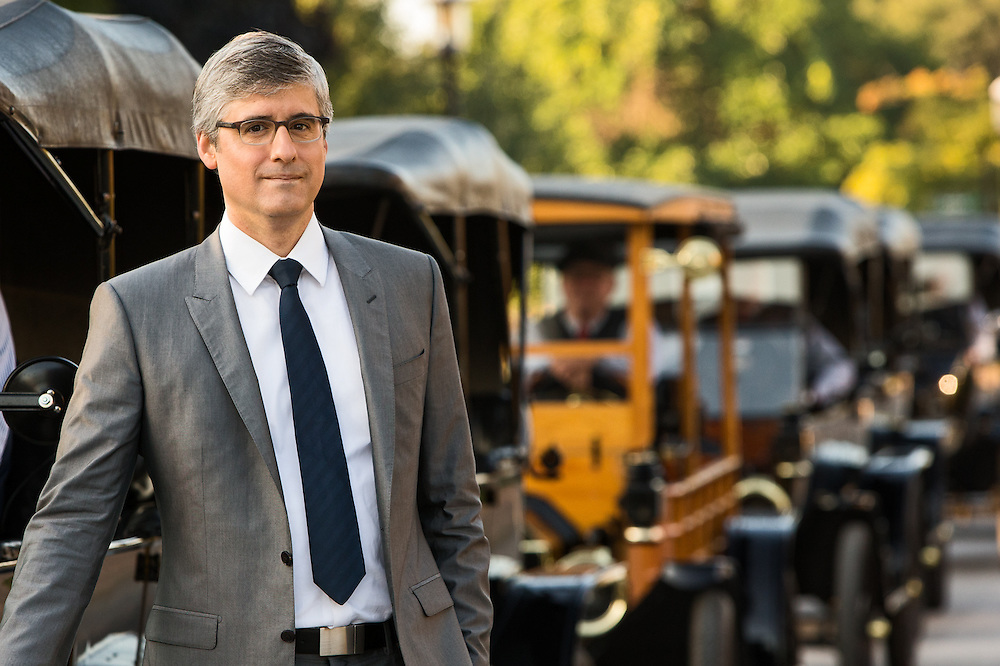 Mo Rocca poses in front of Model T's while filming CBS Saturday morning's TV show, The Henry Ford's Innovation Nation at Greenfield Village. Set photography by Kristina Sikora