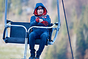 Poland, Wisla Malinka - 2017 November 19: Adam Malysz on ski lift while Men&rsquo;s Individual HS134 competition during FIS Ski Jumping World Cup Wisla 2017/2018 - Day 3 at jumping hill of Adam Malysz on November 19, 2017 in Wisla Malinka, Poland.<br /> <br /> Mandatory credit:<br /> Photo by &copy; Adam Nurkiewicz<br /> <br /> Adam Nurkiewicz declares that he has no rights to the image of people at the photographs of his authorship.<br /> <br /> Picture also available in RAW (NEF) or TIFF format on special request.<br /> <br /> Any editorial, commercial or promotional use requires written permission from the author of image.