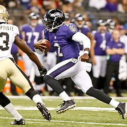 Aug 28, 2014; New Orleans, LA, USA; Baltimore Ravens quarterback Tyrod Taylor (2) runs as New Orleans Saints cornerback Stan Jean-Baptiste (33) pursues during the first half of a preseason game at Mercedes-Benz Superdome. Mandatory Credit: Derick E. Hingle-USA TODAY Sports
