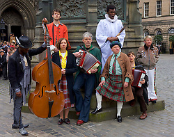 Actors perform a few songs from I am Thomas in costume in Parliament Square, Edinburgh, 23rd March 2016,Actors left to right: John Pfumojena, Dominic Marsh, Amanda Hadingue, Iain Johstone, Charlie Folorunsho, John Cobb, Hannah McPake, Myra McFadyen<br /> (c) Brian Anderson | Edinburgh Elite media