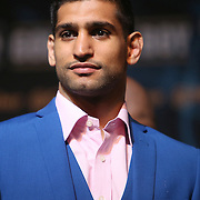 Boxer Amir Khan poses onstage during the undercard final press conference for the Mayweather & Maidana boxing match at the Hollywood Theater, inside the MGM Grand hotel on Thursday, May 1, 2014 in Las Vegas, Nevada.  (AP Photo/Alex Menendez)