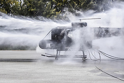 Apr 26, 2017 - Japan - Spray Day. Airmen spray a training helicopter during firefighter training at Kadena Air Base, Japan, April 26, 2017. The airmen are assigned to the 18th Civil Engineer Squadron. Firefighters train on a regular basis to maintain constant readiness for emergencies. Air Force photo by Senior Airman Nick Emerick. (Credit Image: ? Senior Airman Nick Emerick/DoD via ZUMA Wire/ZUMAPRESS.com)