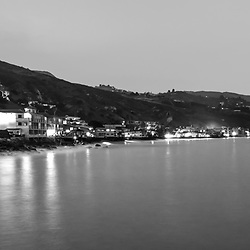 Malibu California at night black and white panorama photo. Malibu is a coastal city along the Pacific Ocean in Southern California in the United States. Panoramic photo ratio is 1:3. Copyright ⓒ 2015 Paul Velgos with All Rights Reserved.
