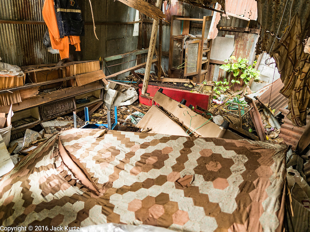 10 AUGUST 2016 - BANGKOK, THAILAND: An abandoned home in the Pom Mahakan slum. Residents of the slum have been told they must leave the fort and that their community will be torn down. The community is known for fireworks, fighting cocks and bird cages. Mahakan Fort was built in 1783 during the reign of Siamese King Rama I. It was one of 14 fortresses designed to protect Bangkok from foreign invaders. Only of two are remaining, the others have been torn down. A community developed in the fort when people started building houses and moving into it during the reign of King Rama V (1868-1910). The land was expropriated by Bangkok city government in 1992, but the people living in the fort refused to move. In 2004 courts ruled against the residents and said the city could take the land. Eviction notices have been posted in the community but most residents have refused to move. Residents think Bangkok city officials will start evictions around August 15, but there has not been any official word from the city.      PHOTO BY JACK KURTZ