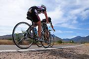 Cyclists make their way to Madera Canyon in the Santa Rita Mountains in the Coronado National Forest near Green Valley, Arizona, USA.