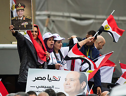 Whitehall, London, November 5th 2015. Pro Sisi demonstrators and counter protesters from UK Egyptian and human rights groups shout each other down outside Downing Street ahead of Egypt's President Abdel Fatah al-Sisi visiting Prime Minister David Cameron at No. 10. PICTURED: Sisi supporters with their Egyptian flags.