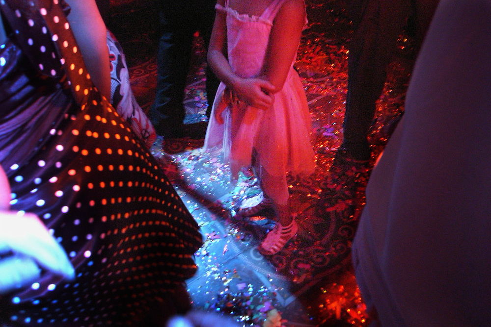 A young girl in the dance floor of a prostitution club in Damascus, Syria. With no permission to work many iraqi refugees turn to prostitution to find a way of living. .(full text upon request).