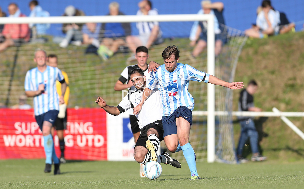 Titus Paterson, battles for possession during the FA Vase 1st Qualifying Round match between Worthing United and East Preston FC at the Robert Eaton Memorial Ground, Worthing, United Kingdom on 6 September 2015. The first home match for Worthing United since losing team mates Matthew Grimstone and Jacob Schilt in the Shoreham air show disaster.