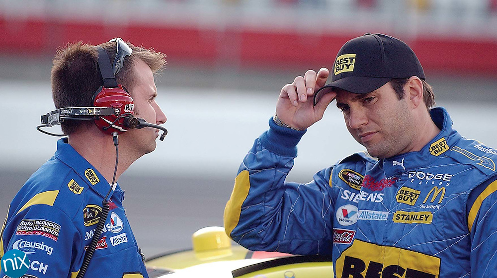 Elliott Sadler talks with a crew member on pit road at Lowe's Motor Speedway Thursday, May 22, 2008 during Windstream Pole Night.  (photo by Bridgett Baker)