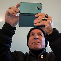 Como, Italy - 9 December 2017: A militant of Italy's neo-fascist Forza Nuova movement takes a selfie after Roberto Fiore's press conference at Palace Hotel. Italy's Democrats led a rally at the same time a few hundreds meters away to warn about a comeback of fascist movements in the country.