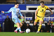 Coventry City midfielder (on loan from Aston Villa) Callum O'Hare (17) looks to pass under pressure from Milton Keynes Dons defender Callum Brittain (25) during the EFL Sky Bet League 1 match between Coventry City and Milton Keynes Dons at the Trillion Trophy Stadium, Birmingham, England on 11 January 2020.