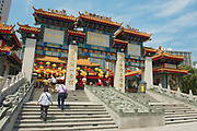 HONG KONG, CHINA - SEPTEMBER 14, 2012: Unidentified people enter Sik Sik Yuen Wong Tai Sin temple at Kowloon in Hong Kong, China.