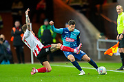Chris Maguire (#7) of Sunderland AFC tackles Joe Jacobson (#3) of Wycombe Wanderers during the EFL Sky Bet League 1 match between Sunderland AFC and Wycombe Wanderers at the Stadium Of Light, Sunderland, England on 11 January 2020.