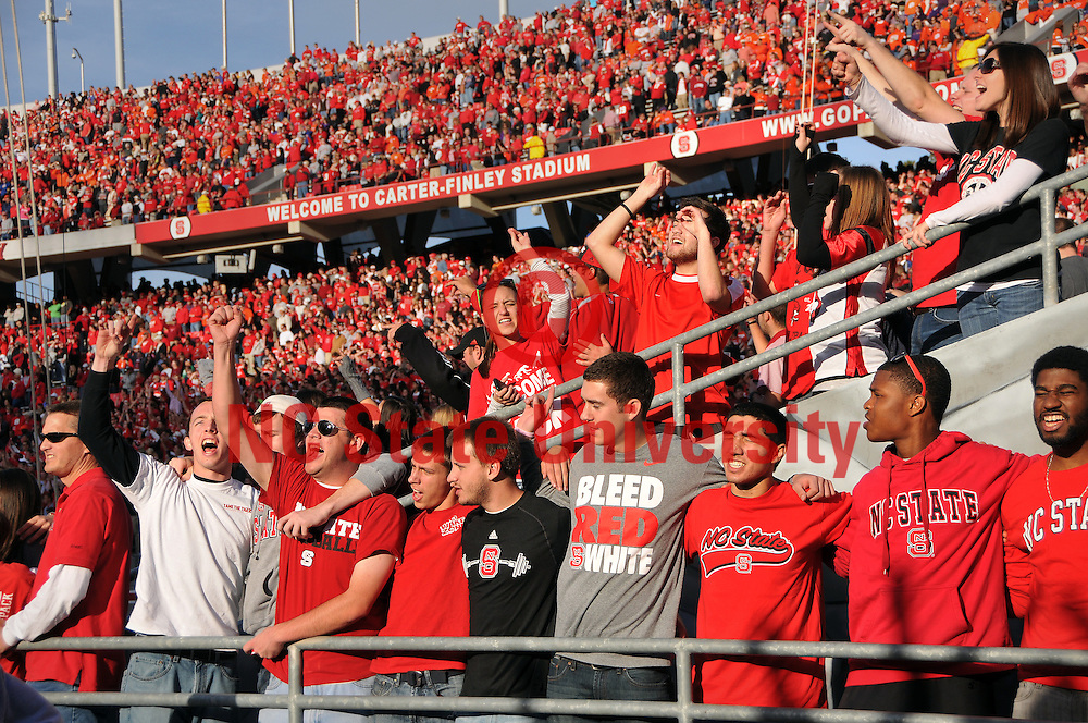 Students sing along with the fight song before the football team enters Carter-Finley Stadium.