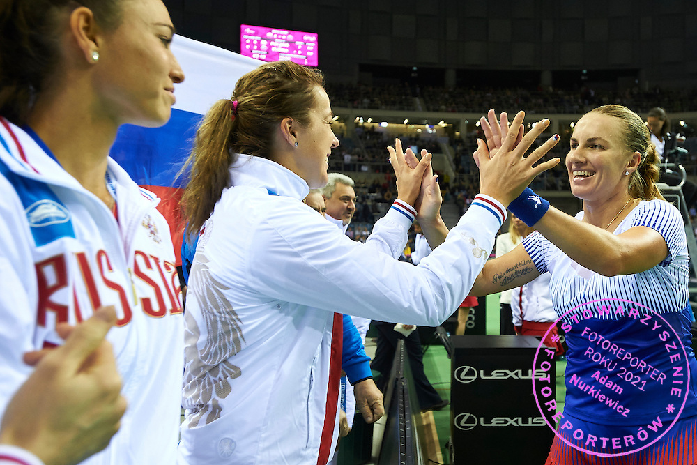 (L) Vitalia Diatchenko and (C) Anastasia Pavyuchenkova congratulate to (R) Svetlana Kuznetsova all from Russia during First Day of the Fed Cup / World Group 1st round tennis match between Poland and Russia at Tauron Krakow Arena on February 7, 2015 in Cracow, Poland.<br /> <br /> Poland, Cracow, February 7, 2015<br /> <br /> Picture also available in RAW (NEF) or TIFF format on special request.<br /> <br /> For editorial use only. Any commercial or promotional use requires permission.<br /> <br /> Adam Nurkiewicz declares that he has no rights to the image of people at the photographs of his authorship.<br /> <br /> Mandatory credit:<br /> Photo by &copy; Adam Nurkiewicz / Mediasport