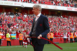 Arsenal manager Arsene Wenger takes his tie off after giving an address to the fans