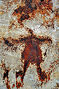 Abstract rust close-up in red and brown. With a bit of imagination a human figure can be seen in the mess