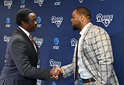 Apr 6, 2018; Thousand Oaks, CA, USA; Los Angeles Rams defensive tackle Ndamukong Suh (right) shakes hands with CBS Los Angeles KCBS/KCAL broadcaster Jim Hill at a press conference at Cal Lutheran.