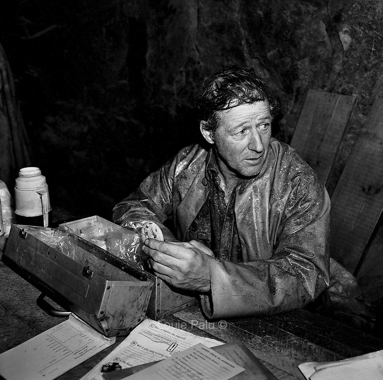 Lunch break, 1450 foot level refuge station, Kerr Mine, Virginiatown, Ontario. From the book Cage Call: Life and Death in the Hard Rock Mining Belt. An in-depth project spanning over 12-years examining communities in one of the richest mining regions in the world located in Northwestern Ontario and Northeastern Quebec in Canada.