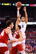 06 APR 2015:  Guard Tyus Jones (5) of Duke University shoots over Guard Traevon Jackson (12) of the University of Wisconsin during the championship game at the 2015 NCAA Men's DI Basketball Final Four in Indianapolis, IN. Duke defeated Wisconsin 68-63 to win the national title. Brett Wilhelm/NCAA Photos