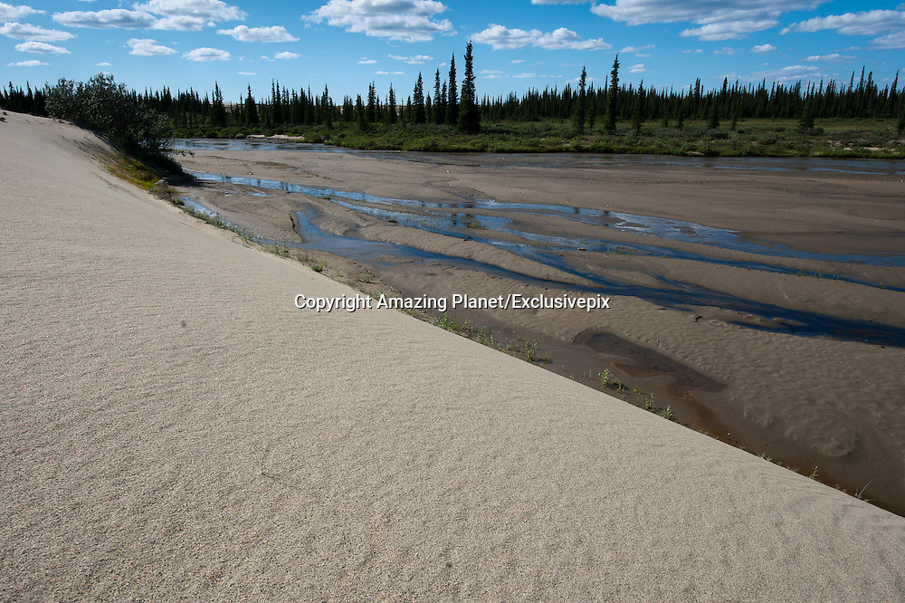 The Great Kobuk Sand Dunes - An Alaskan Oddity<br /> <br /> The Kobuk Valley National Park, in Alaska, is one of the most remotely located national parks in the world. Situated on the edge of the arctic circle, this park has no roads that lead to it. The only way to reach it is by foot or sled, or by chartered air taxis. No wonder, it is one of the least visited in the National Park System. Enclosed within the 1.7-million-acres park, lies the Great Kobuk Sand Dunes, one of Alaska's true oddities, and a vestige of the immense continental glaciers that once covered much of North America.<br /> <br /> The Kobuk Valley National Park contains, not one but three active sand dunes: the Great Kobuk Sand Dunes, the Little Kobuk Sand Dunes and the Hunt River Dunes, that together cover 20,000 acres of land, but at one time covered as many as 200,000 acres immediately after the retreat of Pleistocene glaciation. The dunes were believed to have formed by the grinding action of glaciers and subsequent deposition of sand by glacial-outwash streams emptying into what was once a large lake in the Kobuk valley, some 150,000 years ago. The 25-square-km Great Kobuk Sand Dunes constitute the largest active sand dunes found in the Arctic.<br /> ©Amazing Planet/Exclusivepix