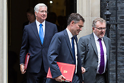 London, September 5th 2017. Defence Secretary Michael Fallon (left), Secretary of State for Work and Pensions David Gauke and Scotland Secretary David Mundell leave  the first UK cabinet meeting at Downing Street after the summer recess. ©Paul Davey