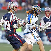 Paul Rabil #99 of the Boston Cannons looks to grab a loose ball during the game at Harvard Stadium on May 17, 2014 in Boston, Massachuttes. (Photo by Elan Kawesch)