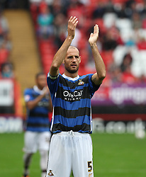Doncaster Rovers' Rob Jones claps the fans at the end of the abandoned game  - Photo mandatory by-line: Robin White/JMP - Tel: Mobile: 07966 386802 24/08/2013 - SPORT - FOOTBALL - The Valley - Charlton -  Charlton Athletic V Doncaster Rovers - Sky Bet League Two