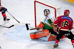 Edo Hafner vs goalie Luka Simsic during ice-hockey friendly match between legends of HDD Tilia Olimpija and HK Acroni Jesenice, on April 14, 2012 at SRC Stozice, Ljubljana, Slovenia. (Photo By Matic Klansek Velej / Sportida.com)