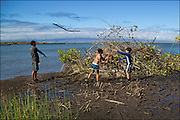 Participants help clean up the Keawanui Fishpond on Molokai.