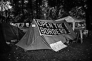 A tent in the station camp with a sign requesting the opening of the Swiss border