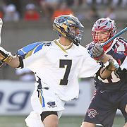 Jake Tripucka #7 of the Charlotte Hounds controls the ball during the game at Harvard Stadium on May 17, 2014 in Boston, Massachuttes. (Photo by Elan Kawesch)