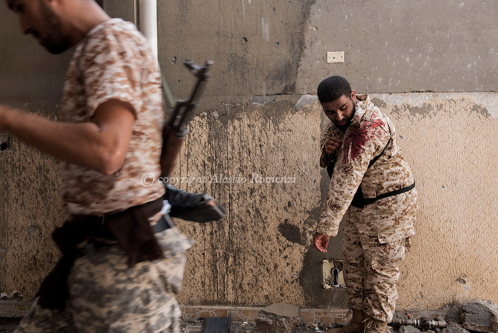 Libya: a fighter affiliated with Libya's Government of National Accord's (GNA) wash up is fatigue from the blood of an injured comrade. Alessio Romenzi