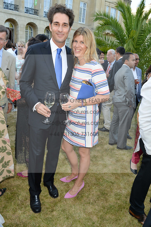 KATIE ELLIOT and YOUNES ZRIKEM at the Quintessentially Foundation and Elephant Family 's 'Travels to My Elephant' Royal Rickshaw Auction presented by Selfridges and hosted by HRH The Prince of Wales and The Duchess of Cornwall held at Lancaster House, Cleveland Row, St.James's, London on 30th June 2015.