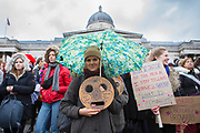 UNITED KINGDOM, London: 04 March 2018 A woman shows her support at the #March4Women rally in Trafalgar Square this afternoon. Thousands of people marched from Parliament to Trafalgar Square to celebrate International Women's Day and 100 years since the first women in the UK gained the right to vote. <br /> Rick Findler / Story Picture Agency