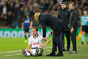 Having fallen at the feet of Inter Milan manager Luciano Spalletti Tottenham Hotspur forward Harry Kane (10) gets a hand up during the Champions League group stage match between Tottenham Hotspur and Inter Milan at Wembley Stadium, London, England on 28 November 2018.