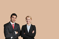 Portrait of young business team with arms crossed over colored background