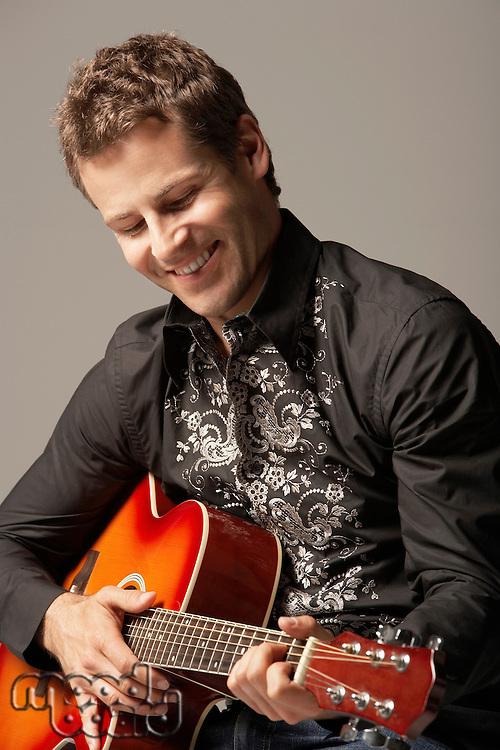 Man Playing Guitar smiling close-up